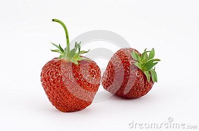 Two strawberries leaning