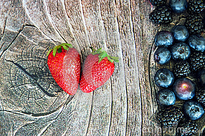 Two strawberries on wood