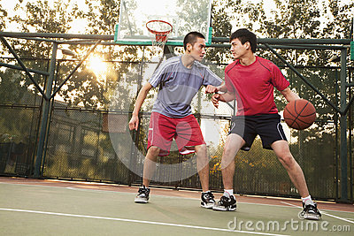 Two street basketball players on the basketball court