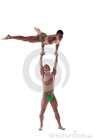Two strong men show gymnastic performance isolated