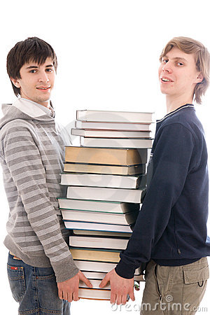 Two students with books isolated on a white