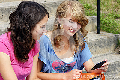 Two students reading on cell phone