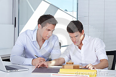 Two students at their desk