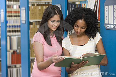 Two students working in university library