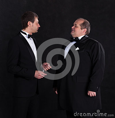 Two stylish businessman in tuxedos