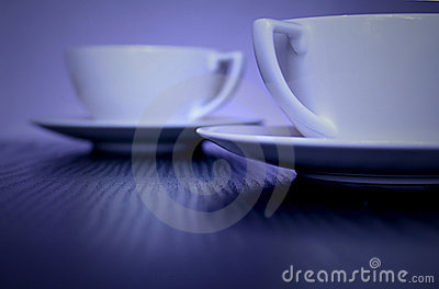 Two Stylish White  Cups on table