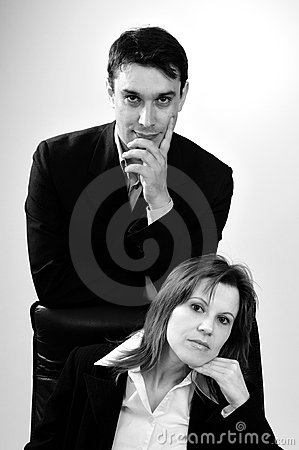 Two successful business people portraits
