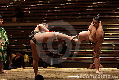 Two sumo wrestlers getting ready for a fight Editorial Image