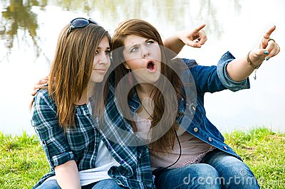 Two surprised  young teens