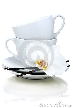 Two teacups, vanilla and flower.