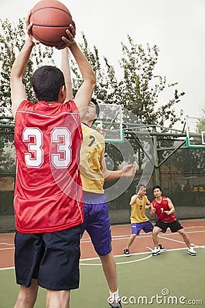 Two teams playing basketball