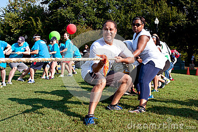 Two Teams Pull Ropes In Adult Tug-Of-War Fundraiser