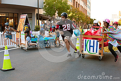 Two Teams Race Beds In Fundraiser Mattress Race Editorial Stock Image