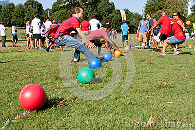 Two Teams Sprint For Balls To Begin Dodge Ball Game
