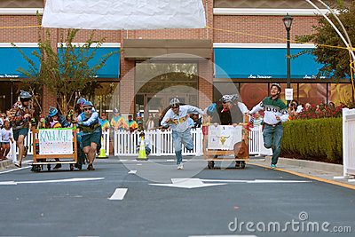 Two Teams Sprint To Finish Of Bed Race Editorial Photography