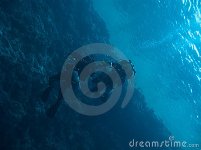 Two technodivers drift under the ocean surface