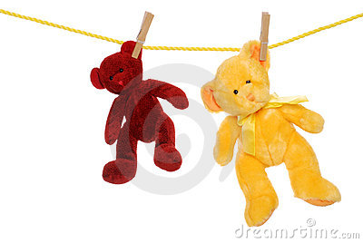 Two teddy bears on clothesline
