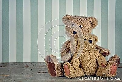 Two teddy bears hugging