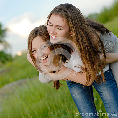 Free Two Teen Girl Friends Laughing Having Fun In Spring Or Summer Outdoors Stock Photos - 33552053