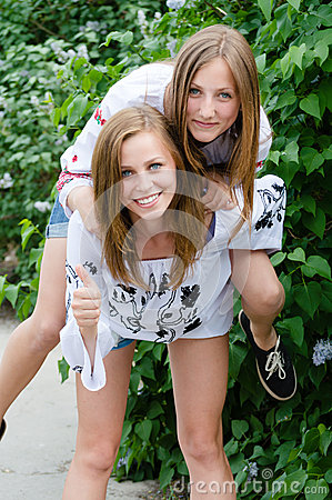 Free Two Teen Girl Friends Laughing  In Spring Or Summer Outdoors Royalty Free Stock Images - 35916589