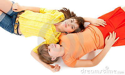 Two teen girls lie side by side