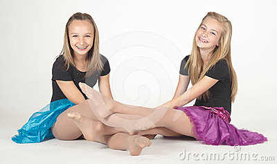 Two Teen Girls Modeling Fashion Clothes in Studio