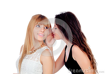 Two teen sisters whispering