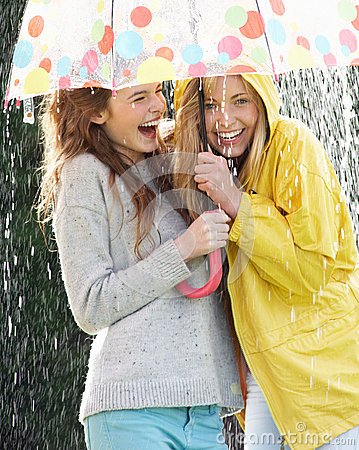 Free Two Teenage Girl Sheltering From Rain Beneath Umbrella Royalty Free Stock Images - 33080769