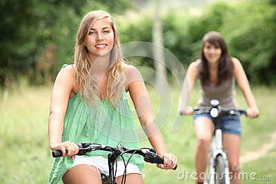 Two teenage girls cycling