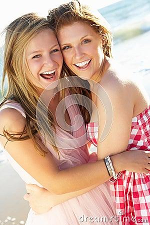 Two Teenage Girls Enjoying Beach Holiday Together