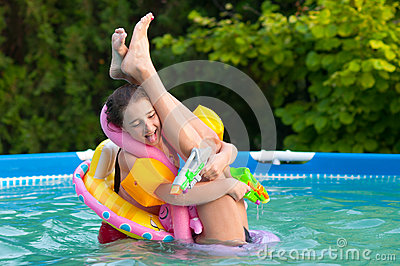 Two teenage girls having fun in the pool