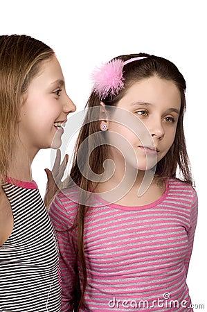 Two teenage girls sharing secrets