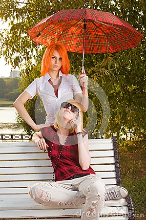 Two teenage girls at summer park