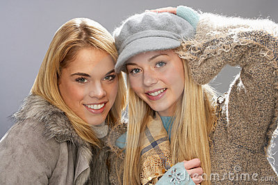 Two Teenage Girls Wearing Knitwear In Studio