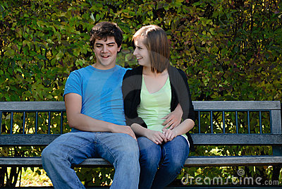 Two Teenagers On A Bench