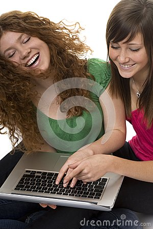 Two teenagers with laptop computer