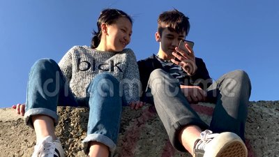 Image of: Youtube Two Teenagers Sitting In The Street And Watching Funny Videos On The Phone Stock Video Video Of Bottom Looking 121791863 Funny Two Teenagers Sitting In The Street And Watching Funny Videos On The