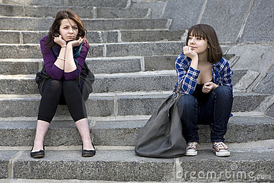Two teens girl sitting on stairs