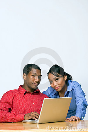 Two Teens With Laptop Computer - Vertical