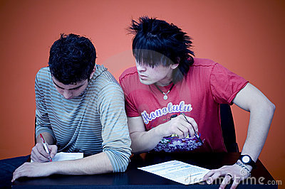 Two Teens Taking Exam