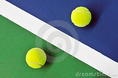 Two tennis balls on the tennis court