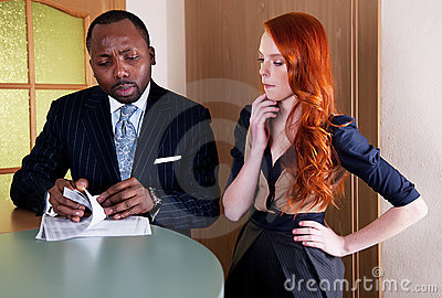 Two thinking coworkers at office counter