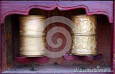 Two Tibetan Buddhist prayer wheels