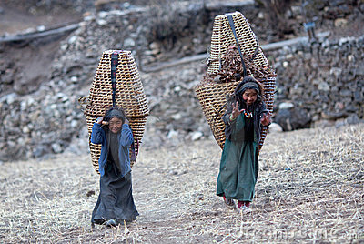 Two tibetan girls with basket Editorial Photo