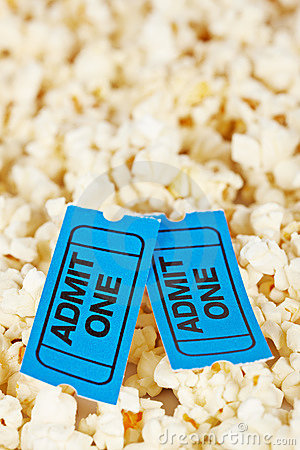 Two tickets on popcorn background
