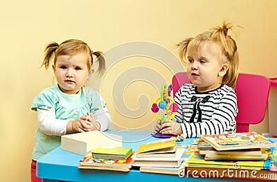 Two toddler girls playing
