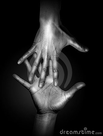 Two touching human hands