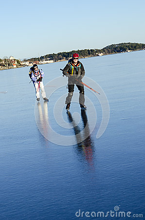 Two tour skaters on smoth ice