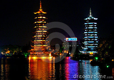 Two towers in night in a lake of Guilin