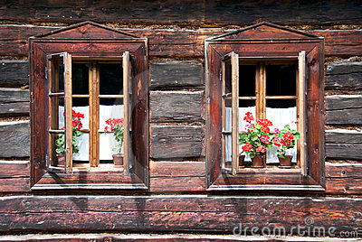 Two Traditional Opened Woden Windows with Flowers